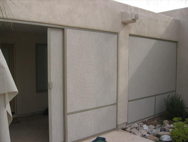 Patio slider open screened with stucco