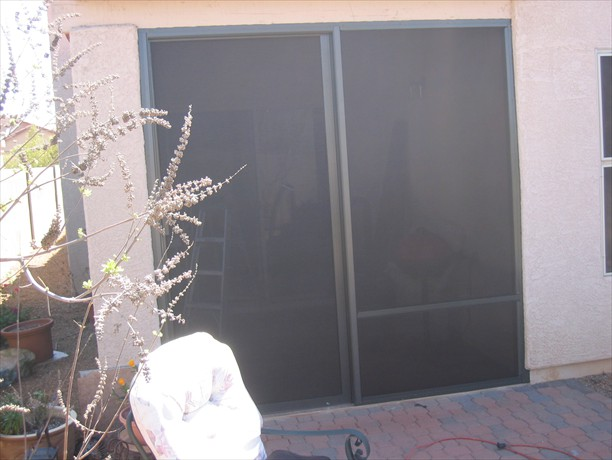 Sliding screen door and fixed panel